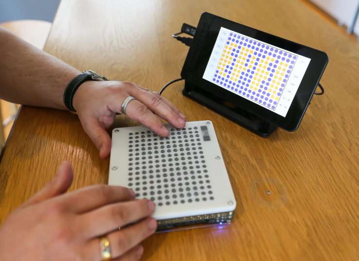 A user interacts with the BlindPad interface