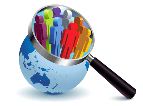 Image of a world globe with a magnifying glass focusing on a group of people.
